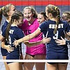 Shady Spring celebrates after beating Robert C Byrd in the semi-final match of the Girl Calss AA State Volleyball Tournament held at the Charleston Civic Center Friday afternoon. <br /> (Rick Barbero/The Register-Herald)