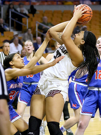 (Brad Davis/The Register-Herald) Woodrow Wilson's Jamara Walton shoots from underneath the basket as Morgantown's Alayjah Jones defends during  Girls State Basketball Tournament Wednesday afternoon in Charleston.