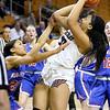 (Brad Davis/The Register-Herald) Woodrow Wilson's Jamara Walton shoots from underneath the basket as Morgantown's Alayjah Jones defends during  Girls State Basketball Tournament Wednesday afternoon in Charleston.