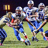 Midland Trail QB Chris Vines picks up ground yards as Shady Spring's Bryson Pinardo, left, and Adam Richmond converge on the tackle during Friday evening  action in Shady Spring. F. Brian Ferguson