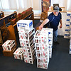 Brian Beckett, truck driver, places labels on boxes of nonperishable food items at the Salvation Army on South Fayette Street in Beckley Monday afternoon for volunteers of the United Way to deliver to seniors and other families. 102  boxes of food was provided to the Salvation Army by Mountaineer Food Bank with 52 going to the United Way and 50 to Bethel Church in Nicholas County for distribution.<br /> (Rick Barbero/The Register-Herald)