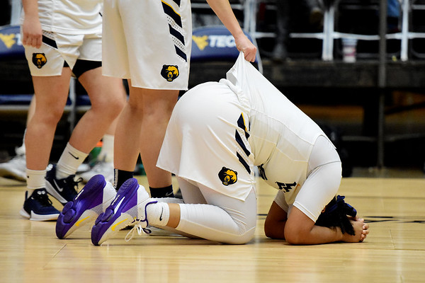 WVU Tech's Alexandria Gray (10) is consoled by Brittney Justice after their lose to IU Kokomo in the River State Confernece quarterfinal game in Beckley on Wednesday. (Chris Jackson/The Register-Herald)
