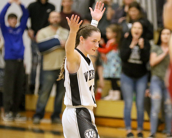 (Brad Davis/The Register-Herald) Westside's Makayla Morgan urges fellow students and fans to get up and cheer as the clock winds down and the Renegades claim the victory over Bluefield in the Class AA Region 3 co-final Thursday night in Clear Fork.