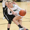 (Brad Davis/The Register-Herald) Wyoming East's Skylar Davidson drives from the perimeter as Westside's Makayla Morgan defends during Friday action at the New River Community and Technical College Shootout at the Beckley-Raleigh County Convention Center.