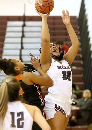 (Brad Davis/The Register-Herald) Woodrow Wilson's Jamara Walton drives to the basket as South Charleston's Myra Cuffee defends Wednesday night in Beckley.