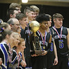 (Brad Davis/The Register-Herald) Princeton players pose with the trophy after defeating Huntington for class AAA Boys Championship during the final day of Big Atlantic Classic action Saturday at the Beckley-Raleigh County Convention Center.