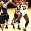 Victora Staunton, of Woodrow Wilson, right, receives a pass against Westside, during the second annual New River CTC Invitational held at the Beckley Raleigh County Convention Center. Woodrow won 60-35.<br /> (Rick Barbero/The Register-Herald)