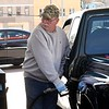 Jack Tolliver, of Beckley, uses precautions because of the coronavirus while pumping gas with a rubber glove on at the Sheets Station on Neville Street in Beckley.<br /> (Rick Barbero/The Register-Herald)