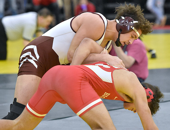 (Brad Davis/The Register-Herald) Woodrow Wilson's Devan Gauldin takes on Parkersburg's Zach Howard in a 195-pound weight class matchup Friday afternoon at the 73rd Annual State Wrestling Tournament in Huntington. Gauldin won the match and would win his next match to make Saturday's finals.