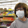 Delores Browning, of Oceana, was one of ten people shopping at Goodson's Supermarket on Valley Drive in Oceana Wednesday morning, because the Health Department on Tuesday reduced the number shoppers to only10 at a time. Goodson's supplied their employees each with face masks and most chosed to wear them and they also offered to shop for their customers avoiding long wait times to enter the store.<br /> (Rick Barbero/The Register-Herald)