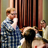 Zach Bolon, director of performing arts, works with youth performers prior to rehearsal for Frozen Jr. at the theater at Tamarack on Tuesday. (Chris Jackson/The Register-Herald)