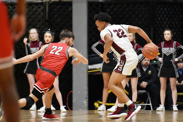 Woodrow Wilson's Richard Law (22) dribbles behind his back to get a loose ball from St. Albans Ethan Clay (22) during the first half of their basketball game in Beckley on Tuesday. (Chris Jackson/The Register-Herald)