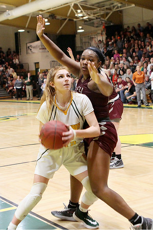 Greenbrier East's Emma Dotson drives while Woodrow Wilson's Victoria Staunton defends during the Class AAA Region 3 Section 2 championship game at Greenbrier East Friday. (Jenny Harnish/The Register-Herald)