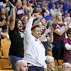 (Brad Davis/The Register-Herald) Woodrow Wilson fans and family celebrate a win as time runs out in their win over Morgantown Wednesday afternoon in Charleston.