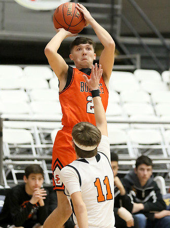 (Brad Davis/The Register-Herald) Summers County's Dawson Ratliff shoots from three-point range as Richwood's Aiden Miller defends during Big Atlantic Classic action Wednesday night at the Beckley-Raleigh County Convention Center.