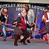 "(Brad Davis/The Register-Herald) Michael Flannery, crouching middle, and teammates (from left) Eric Bragg, Tony Martin and Omar Khan get down on the dance floor during the team competition portion of the Hunks in Heels ""Fur"" Real fundraising event Friday night at the Beckley Moose Lodge."