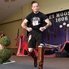 "(Brad Davis/The Register-Herald) Chris McKinney flexes for the camera during the Hunks in Heels ""Fur"" Real fundraising event Friday night at the Beckley Moose Lodge."