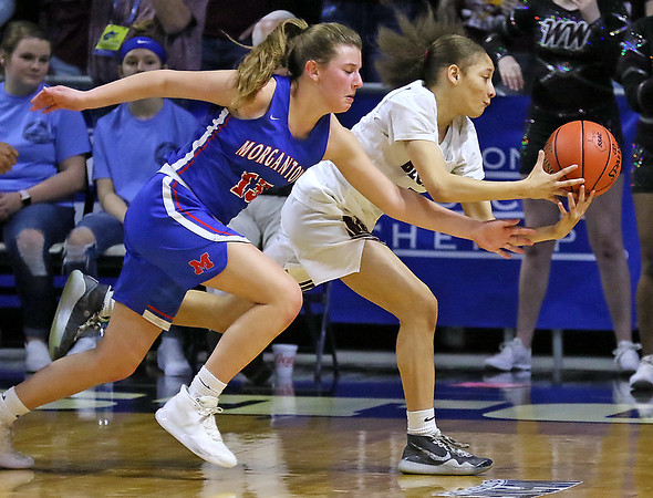 (Brad Davis/The Register-Herald) Woodrow Wilson's Keanti Thompson gets one of her five steals on the day as Morgantown's Cat Wassick is victimized during Girls State Basketball Tournament Wednesday afternoon in Charleston.
