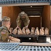 Dawson Murphy, W.Va. National Guard 115th Clarksburg unit, left, and Dawson Markley load up bags of meals prepared by Tamarack in Beckley Monday morning. Tamarack joined together with Raleigh County and Monroe schools to provide two meals a day for five day to 1500 students from each county. 1500 meals were delivered to Monroe County Monday morning and additional 1500 meals will be prepared and delivered in Raleigh by the W.Va. National Guard to help continue feeding students during the coroanvirus crisis.<br /> (Rick Barbero/The Register-Herald)