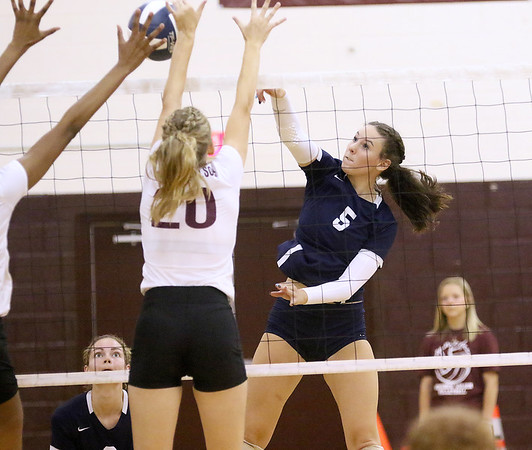 (Brad Davis/For The Register-Herald) Shady Spring's Chloe Thompson attacks as Woodrow Wilson's Emily Stack tries to block during Shirley Brown Invitational action Saturday morning in Beckley.
