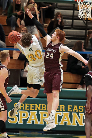Woodrow Wilson's Ben Gilliam tries to block Greenbrier East's Adam Seams during Saturday's Class AAAA Region 3, Section 2 game against Woodrow Wilson at Greenbrier East in Fairlea. Jenny Harnish for the Register-Herald