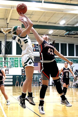 Kayley Bane (Wyoming East) goes up for two over Harvey of Summers County.