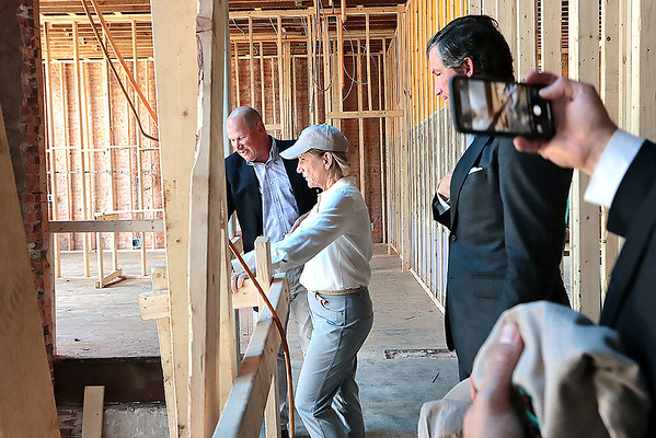 Sen. Shelley Moore Capito tours the new Schoolhouse Hotel with president and CEO of The Disability Opportunity Fund Charles Hammerman in downtown White Sulphur Springs Friday. Jenny Harnish for the Register-Herald