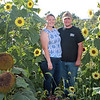 Jade and Alex Hanna in their sunflowers on The Hanna Farmstead in Maxwelton Saturday. The couple is having games, barrel rides, wagon rides, roasted corn and sunflowers at their agro-tourism farm on weekends through October 31. Jenny Harnish/The Register-Herald