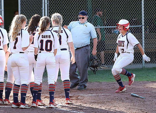 Independence's Kaylen Parks is welcomed at home plate by her teammates after hitting a homerun.