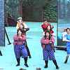 The cast dances during the opening number of Alice in <br /> Wonderland at the Grandview Ampitheater. Jon C. Hancock/for the Register-Herald