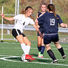 (Brad Davis/For The Register-Herald) Oak Hill's Jade Babkirk tries to dance around Shady Spring defender Mallie Lawson Monday evening at the YMCA Paul Cline Memorial Sports Complex.