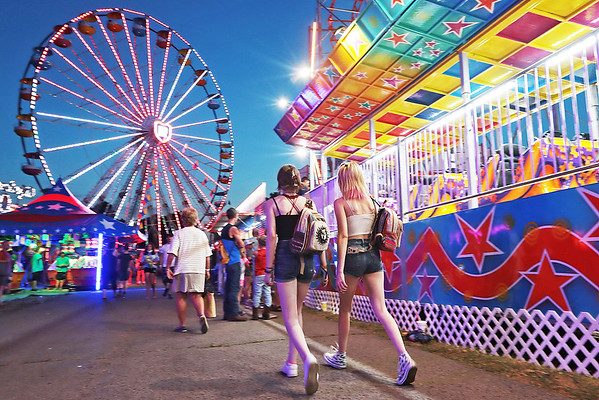 Fairgoers attend opening day of the State Fair of West Virginia in Fairlea Thursday. Jenny Harnish/The Register-Herald