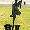 Helmet, rifle and boots representing fallen soldiers on display at the war memorial in Coal City. Jon C. Hancock/for The Register-Herald