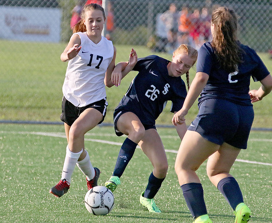 (Brad Davis/For The Register-Herald) Shady Spring's Reece Keffer battles for possession with Oak Hill's Riley Lemon Monday evening at the YMCA Paul Cline Memorial Sports Complex.