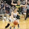Woodrow's Cloey Frantz pushes the ball around Greenbrier East's Brooke Davis. Jon C. Hancock/for The Register-Herald