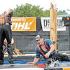 Lumberjacks Trask Hill, left, and Mike Pakos compete in a log rolling competition at the Timberworks Lumberjack Show at the State Fair of West Virginia Thursday. Jenny Harnish/The Register-Herald