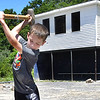 Bentley Rose, 9, played for the Braves in the Miner League at Shady Spring Little League, breaks away concrete from a post the league is salvaging to use when they locate a place for new fields. They are moving  after 43 seasons due to the expasion of Shady Spring Elementary School.<br /> (Rick Barbero)