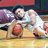 Woodrow Wilson's Elliah Redfern , left, and Oak Hill's Omar Lewis fight for the ball during Thursday action in Oak Hill. F. Brian Ferguson