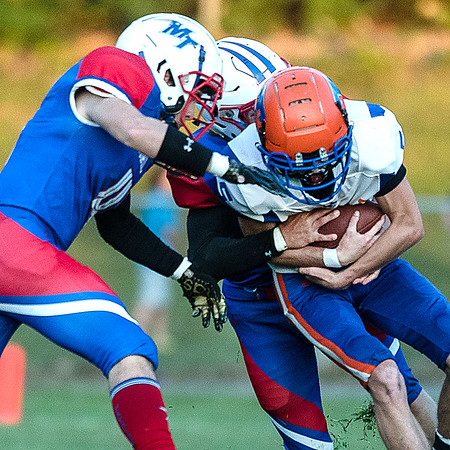 Eli Blackburn is double-teamed by a pair of Midland Trail defenders. Chad Foreman for the Register-Herald.
