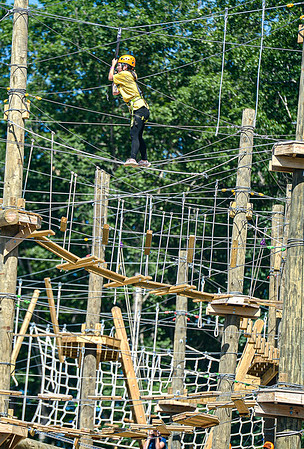 Girl Scout Key Hibbard of Athens, OH tackles the Adventure Park on Monday at Ace Adventure Resort. Souts from around the country converged on the resort for a week of outdoor adventure. F. Brian Ferguson/Register-Herald
