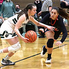 Wyoming East's Abby Russell driving past Claire Dingess, of Chapmanville.<br /> Jim Cook/for the Register-Herald