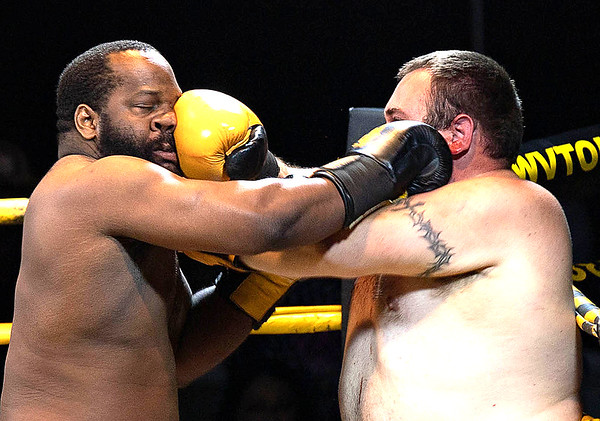 Aaron Hairston wins against Nathan Glenn during the Thoughman Contest.<br /> Tina Laney/for The Register-Herald