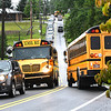 School buses and a line of vehicles traveling Crescent Road in Beckley dropping students off for the first day of school at Crescent Elementary.