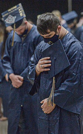 F. Brian Ferguson/Register-Herald  Shady Spring graduates take a moment for prayer during Friday's graduation at the Beckley-Raleigh County Convention Center.