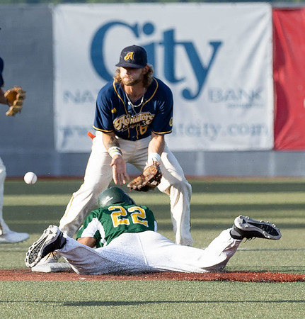 Isaiah Ortegaea-Jones for the WV Miners slides into 2nd base safely while 2nd baseman Mike Snyder for the Lafayette Aviators awaits the throw.<br /> Tina Laney/for The Register-Herald