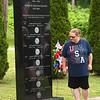 Christine Richardson, of Omigo, looks over the Bluehawk Memorial in Sophia.<br /> (Rick Barbero/The Register-Herald)