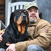 Beckley VA Medical Center nurse Eric Jefferies tested postive for COVID-19, sits with his dog Gus on his front porch on Robin Roost Road in Jumping Branch. Jefferies will be in isolation until Sunday, January 10.<br /> (Rick Barbero/The Register-Herald)