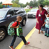 Theresa Lewis, principal Crescent Elementary School, walks students into the gym during parent drop off Tuesday morning for the first day of school in Raleigh County.<br /> (Rick Barbero/The Register-Herald)