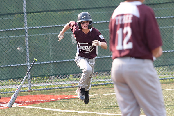 Beckley's Tyler Wilhite tries to make it to 1st base during the State Little League game against Barboursville Tuesday in Lewisburg. Jenny Harnish/The Register-Herald