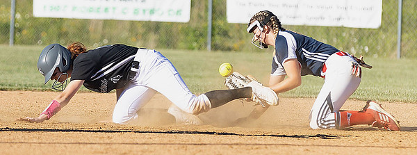Mikayla King of Wyoming East beats the throw to Allie Hypes of Independence for a double. <br /> Tina Laney for Register-Herald